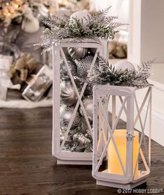 This Christmas, add an elegant yet simple feel to your decor with a stunning combination of silver and white. This Christmas, add an elegant yet simple feel to your decor with a stunning combination of silver and white. Silver Christmas Decorations, Christmas Lanterns, Christmas Fireplace, Christmas Centerpieces, Christmas Themes, Apartment Christmas Decorations, Christmas Mantles, Christmas Villages, Classy Christmas