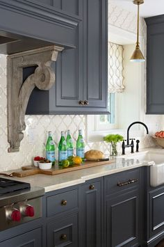 Kitchen Ideas. Kitchen Charcoal Cabinet Paint Color. Kitchen Antique Brass Hardware. Kitchen Arabesque Backsplash. Kitchen Crema Marfil Countertop. Kitchen Pendant Above Famrhouse Sink. Kitchen Hood Corbel. #Kitchen Designed by Sarah Nardi of Elsie Interior.: