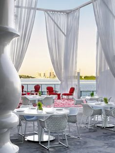 breezy curtians covering a breakfast patio over looking the river. @Andrea Couvillion, you'd love this place!