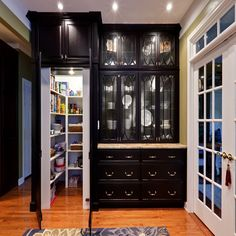 Hidden Walk-in Pantry – The hidden pantry is a great design as when it's closed it looks like a stylish cabinet. The walk-in pantry has a huge storage space to hold all your groceries and the cabinet itself is great for storing plates and bowls. Hidden Pantry, Built In Pantry, Hidden Kitchen, Small Pantry, Hidden Storage, Hidden Closet, Small Storage, Kitchen Pantry Design, Kitchen Pantry Cabinets