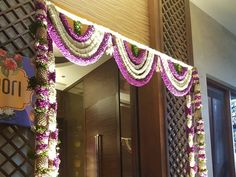 Colourful flowers n pineapples arranged for entrance. Door Flower Decoration, Flower Decorations, Wedding Hall Decorations, Marriage Decoration, Wedding Set Up, Card Box Wedding, Indian Wedding Flowers, Housewarming Decorations, Wedding Doors
