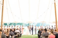 tented wedding ceremony | A.J. Dunlap
