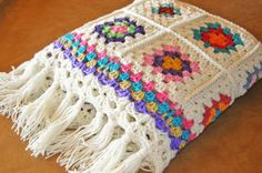 Another traditional granny square afghan done in bright modern colors and a long fringe.