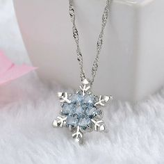 CRYSTAL SNOWFLAKE NECKLACE A high quality necklace with a beautiful crystal snowflake pendant. Silver Pendant Necklace, Crystal Pendant, Silver Necklaces, Crystal Necklace, Pendant Jewelry, Diamond Necklaces, Silver Jewelry, Flower Necklace, Flower Pendant