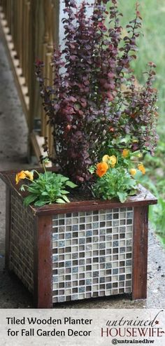 make a tiled garden container planter for frugal upscale decor, container gardening, diy, flowers, gardening, how to, perennial, This simple wooden container was transformed into upscale garden and porch decor with 20 worth of tiles Stunning transformation It s planted with a Japanese barberry and bright orange violas for a fiery fall color scheme