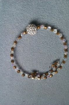 donnasdream jewelry........Brown/White Shine Wrap. Starting at $3 on Tophatter.com!