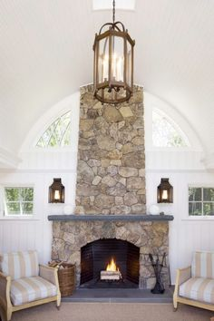 Circular white paneled ceiling and the gorgeous stone fireplace.