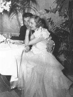 """Cesar Romero and his """"date,"""" Carole Lombard, hostess of the White Mayfair Ball"""