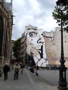 jef Aerosol in paris with a giant stencil