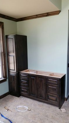 Custom Vanity Base And Linen Tower With Knotty Alder Wood Doors Finished Sherwin Williams Ebony Stain Clear Coated