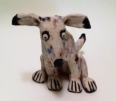Margit Hohenberger  does a little dog in clay