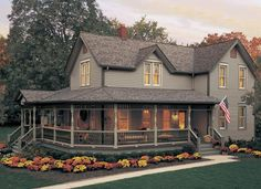 Don't like the shingles but like the porch and coloured siding