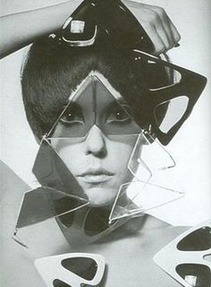Peggy Moffitt with sixties vidal sassoon haircut to complement Oliver Goldsmith pyramid eyewear.