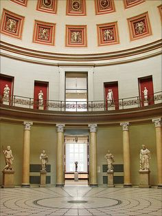 Altes Museum (Berlin) Karl Friedrich Schinkel.  Rotunda, Altes Museum, 1823-1830; Berlin; Karl Friedrich Schinkel.  Interiors of public places bear the Empire Style; Corinthian order, Pantheon effect, coffered ceilings, niches, and statues.  German Greek Revival, Biedermeir.