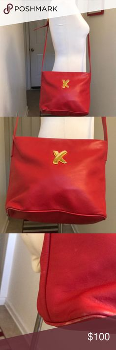 Vintage Paloma Picasso Red Leather Crossbody Bag😘 Title Says it All 😘😘 This red leather Vintage Paloma Picasso bag is gorgeous and ready to wear. Bag features an adjustable single Crossbody strap. Perfect for any outfit to make it pop. Has the Paloma Picasso medallion on the zipper pull. Bag has slight rub wear to the bottom but nothing major. Rare bag and a collectors piece. Open to all reasonable offers for this bag😘❤️ Paloma Picasso Bags Crossbody Bags