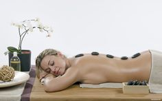 Relaxing stone massage on a massage bench