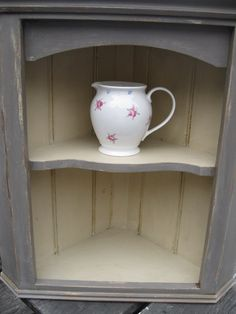 Pretty little hanging corner cupboard in Chalk Paint tm Annie Sloan 'Olive' and 'Cream'...