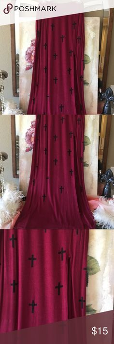 """Foreign Exchange Cross Maxi Skirt w/ high slit M Foreign Exchange maroon red Maxi shirt with cord design in size medium. Has high slit on one side. Also has a short lining at the top that is about 14 1/2"""" long. Measures 14 1/2"""" across, measures 43 1/2"""" waist to hem, 18 1/2"""" across the hips. Slit starts 15 1/2"""" down from the waist.96 percent rayon, 4 percent spandex. Waist has some stretch as well as the skirt. Good condition. Foreign Exchange Skirts Maxi"""