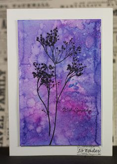 handmade card from Jo Eades ... watercolor panel ... Distress Inks on watercolor paper ... gorgeous!! ... silhouette  flowers stamped on top in black ... nice finshed look with embossed line around the watercolor panel ... beautiful card!!