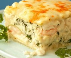 Seafood Lasagna Ingredients: 1/2 cup butter 1/2 cup flour 1/2 teaspoon salt 2 cup garlic; crushed 2 cup milk 2 cup chicken broth 1/4 teaspoon pepper 1 teaspoon basil 2 cup mozzarella cheese, shredded 1/2 cup green onions, chopped 15 each lasagna noodles: uncooked 1 cup cottage cheese; small curd 2/3 cup cooked shrimp cut …