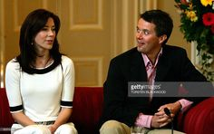 Denmark's Crown Prince Frederik (R) reacts as his Australian-born wife, Crown Princess Mary (L), speaks Danish during their press conference held at Government House in Mary's hometown of Hobart, 11 March 2005. The 13-day official visit is Mary's first to her home country as Scandinavian royalty with Crown Prince Frederik. AFP PHOTO/Torsten BLACKWOOD