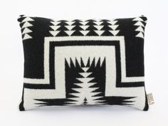 This pillow is hand sewn and made with a Pendleton Woolen Mill wool. The front is black and white with speckles of grey, the reverse side is a pale grey wool. It is stuffed with hypo-allergenic, eco-friendly batting. Pendleton Woolen Mills, in Pendleton, Oregon, has been specializing in incredibly beautiful, high quality wool since 1909. This pillow measures about 16 across and 11.5 top to bottom. It is hand sewn closed so you can spot clean it with soap and water.  Orders within the US will…