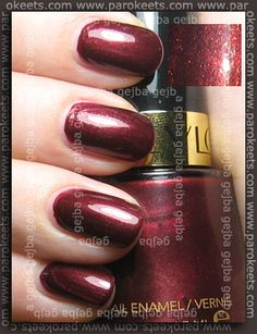Oh, so pretty..Autumn Berry by Revlon: A deep wine red with gold shimmer. Swatched $2.50