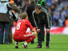 Liverpool FC captain Steven Gerrard is consoled by his friend, Jamie Carragher