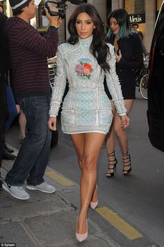 """Kim wears a very """"Rococo-esque"""" dress - Balmain dress-- pastels, encrustation, and small paintings of luscious plants."""