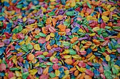 Close up of rainbow dyed oats for sensory play from And Next Comes L