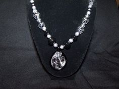 Necklace bracelet and earring beaded set in clear silver and black  http://www.artfire.com/ext/shop/product_view/Lil_Panther_Creations/4786765/Necklace_bracelet_and_earring_beaded_set_in_clear_silver_and_black/Jewelry/Sets/Beadwork#