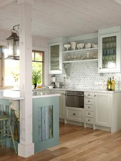 Boards behind trim on cabinet - love this.    Have a Starting Point-While most folks opt for white in the kitchen, this room is bathed in moodier hues. The custom cabinets are painted hunter green and oiled the fir beadboard a golden brown � giving the tight, 75-square-foot spot a jewel box feel. An ivory apron-front sink by Shaws offers a burst of brightness.     Country Living