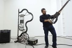 Mexican artist Pedro Reyes makes sweet music from lethal tools. | Bullet harp. | How To Turn 6,700 Weapons Into Musical Instruments