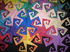 """Triangle Spiral"" by Grael Ruiz, pattern and template by John Flynn"