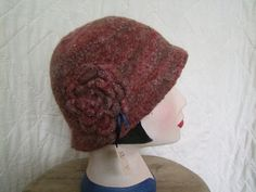 Women's accessories. Downton Abbey Gatsby style hand knitted and felted hat. Hand beaded flower trim. Stylish and practical, this hat is a must-have winter accessory.One of a kind design, hand made in Wales. £20.00 - available from www.liliwenfachknits.co.uk
