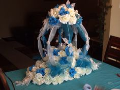 Cinderella Quince Pumpkin Carriage Centerpiece on a Bed Of Roses