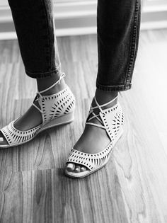 In a smaller wedge version of our favorite Jeffery Campbell Serena Wedge these mini wedges are in a laser cut leather. Featuring an open toe, adjustable lace-up detailing and stacked wedge. Padded footbed for extra comfort. Rubber sole.