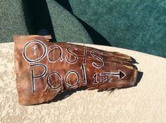 Palm tree bark, hand painted sign for the pool area