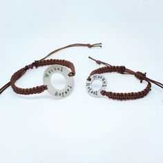 These are beautiful handmade, hand stamped and finished bracelets. Matching bracelets for Dad  and son. You can choose what colour cord you have and also names, dates or words/ phrases can be personalised, space permitting. This would make a lovely Valentines, Fathers Day or Birthday present. Made from stainless steel and Nylon cord.