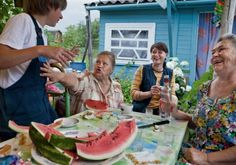 """Russian Summer Jonas Bendiksen """"The dacha is where Russians connect with nature and each other. On weekends (from left) 11-year-old German Shingel; his great-aunt Vera Zhelkina; his mother, Milana; and his grandmother Lyubov Saleyeva gather at their summer home in Valday."""""""