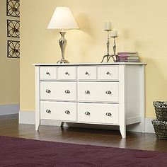 Drawers with metal runners and safety stops feature patented T-lock assembly system.  Four lower drawers are extra deep.  Soft White finish.