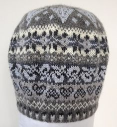 Warm colourful tam hand knitted in 4 ply/fingering yarn to my own original design, based on traditional Fairisle patterns. Hand wash recommended. Please do read my description of the colours Ive used - Im trying to avoid confusion which might arise due to differences in monitor displays.