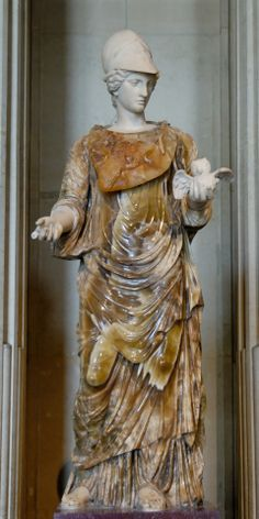 Helmeted Minerva (Athena) holding a tiny owl. Marble and golden onyxmarble, 2nd century AD and 18th century restorations. The onyx body is a Roman copy of the Hera Borghese type; the statue was restored as Minerva by adding marble head and arms.    Courtesy  currently located at the Louvre, France. Photo taken by Jastrow