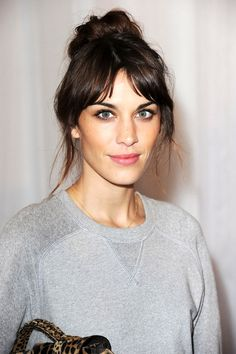 Alexa Chung's messy bun and petal pink lips