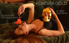 strawberry lolliop with edible gold flakes and 24 karat gold skull