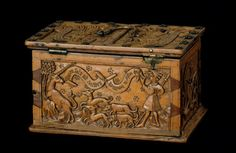 Coffret with carvings of a lady giving a ring to a gentleman, the hunt of the unicorn, and a lover enchained by a woman; Germany, end of the 15th century