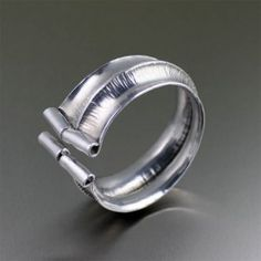 Fold Formed Aluminum Anticlastic Bangle Bracelet - Arrive fashionably cool when you don this spirited Fold Formed Aluminum Bangle Bracelet. The hand-raised anticlastic design coupled with the chased texturing of this big and bold statement piece guarantees an instantly updated look.  http://www.johnsbrana.com/fold-formed-aluminum-anticlastic-bangle-bracelet.html