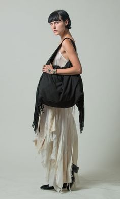 The beautiful Lucy Lawrence wearing our Black Crescent bag in our latest photo shoot