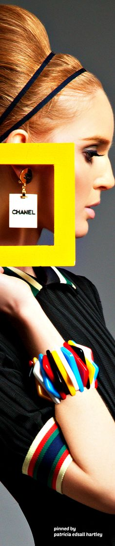 a woman makes her outfit with accessories oscar de la rente