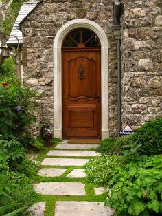 Love the solid look of strength in the dark wood doors....